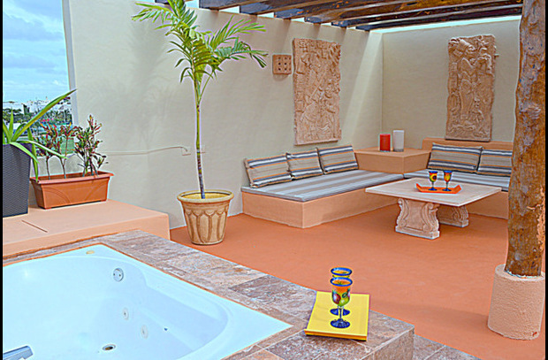 Your Private Roof Top w/Hot Tub & Shaded Social Area featuring Mayan Art Pieces